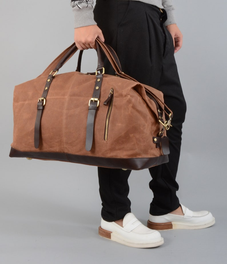 0bd68914b1 Personalised waxed canvas and leather holdall bag in maroon
