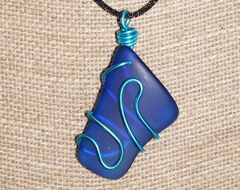 Deep blue glass necklace with blue copper wire