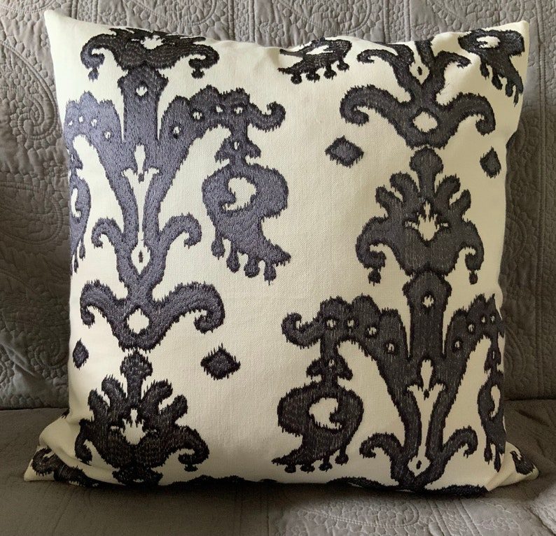 Ikat charcoal grey thread embroidered on white decorator throw image 0