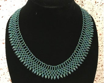 beaded necklace in shades of blue and green