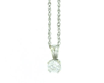 A 0.35ct Round cut diamond set in 14k white gold pendant and hung on a 14k white gold twisted link chain.