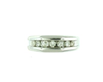 A gentleman's 14k white gold diamond band ring featuring 7 round full cut diamonds totaling 1/2ctw. T