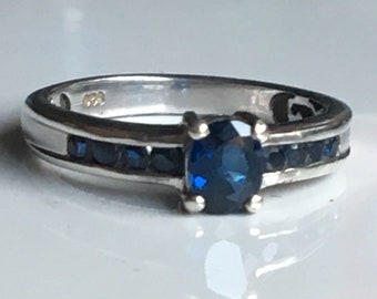 A beautiful vintage Sterling Silver Blue Sapphire Solitaire ring.size is O and has a weight of 2.762 grams.