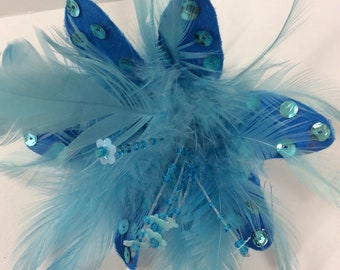 Blue  fascinator hair slide or cosage with sequin detail