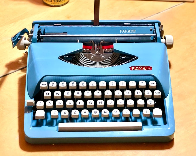 Featured listing image: 1964 Royal PARADE, Portable, Working Manual Typewriter in SKY BLUE
