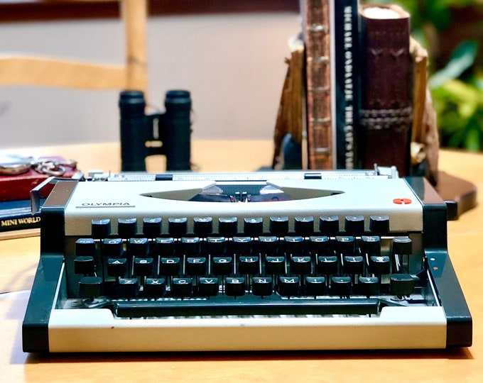 Featured listing image: 1977 Olympia TRAVELLER, ULTRA-PORTABLE Working Manual Typewriter