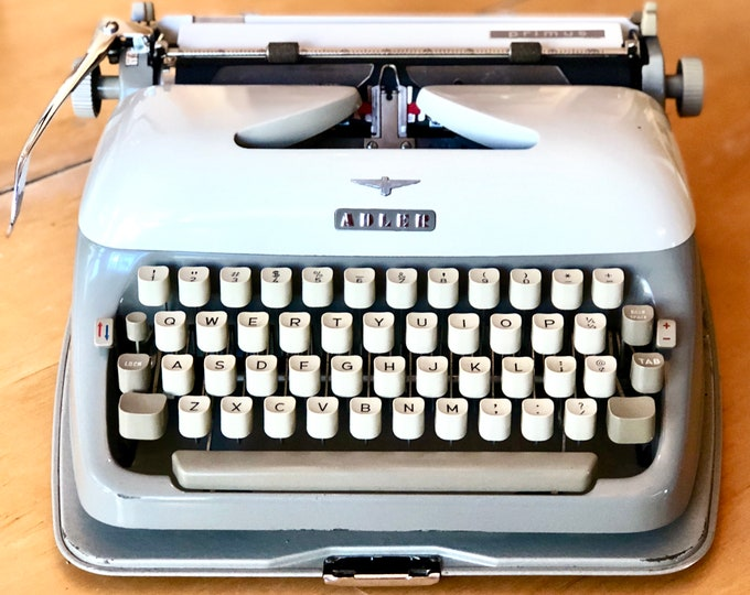 Featured listing image: RARE 1961 Adler PRIMUS, Working Manual Mid-Size Portable Typewriter