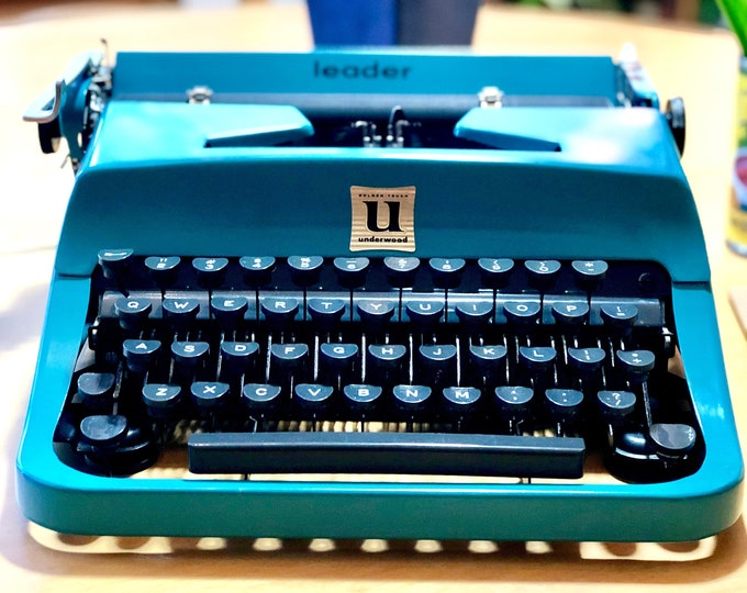 Featured listing image: 1957 Underwood LEADER *GOLDEN TOUCH* Portable, Working Manual Typewriter