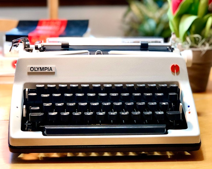 Featured listing image: 1974 Olympia SM9 DE LUXE, Working Manual Portable Typewriter