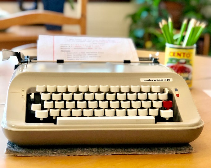 Featured listing image: 1970's OLIVETTI UNDERWOOD 319, Working Manual ULTRA-Portable Typewriter