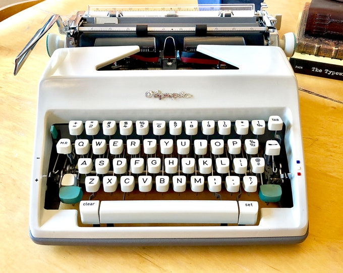 Featured listing image: 1966 Olympia SM8 DeLuxe, *FULLY LOADED* Working Manual Portable Typewriter