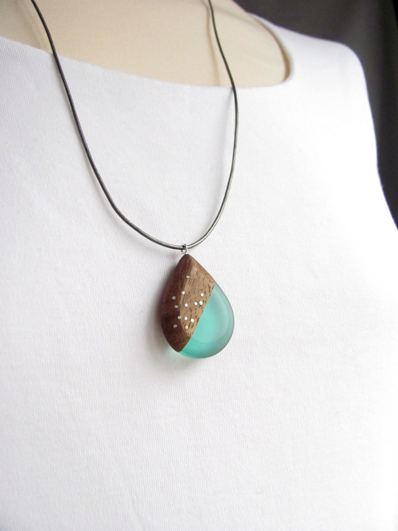 Drop-shaped pendant made of walnut wood and turquoise resin.