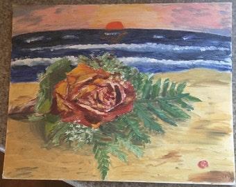 Rose on a beach