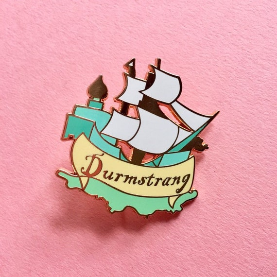 Witchcraft And Wizardry Durmstrang Enamel Pin Etsy Durmstrang once had the darkest reputation of all eleven wizarding schools, though this was never entirely merited. etsy