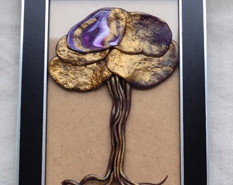 Black frame containing a tree in golden, white and purple fimo paste, for interior decoration or present