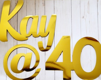 Personalizable photo backdrop name signs. Custom happy birthday backdrop signs. Green grass backdrop signs.