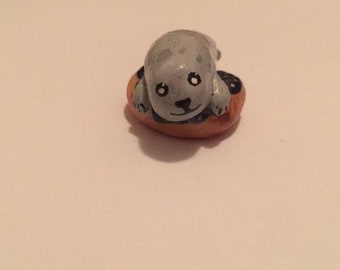 Cute Harbour Seal on a donut polymer clay figurine