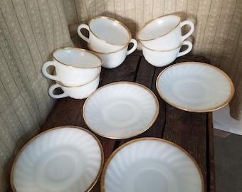 Fire King aniversary cups an d saucers