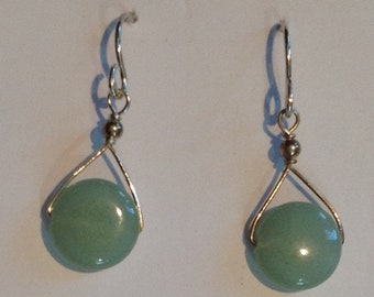 green stone disc dangles from silver plated earwires