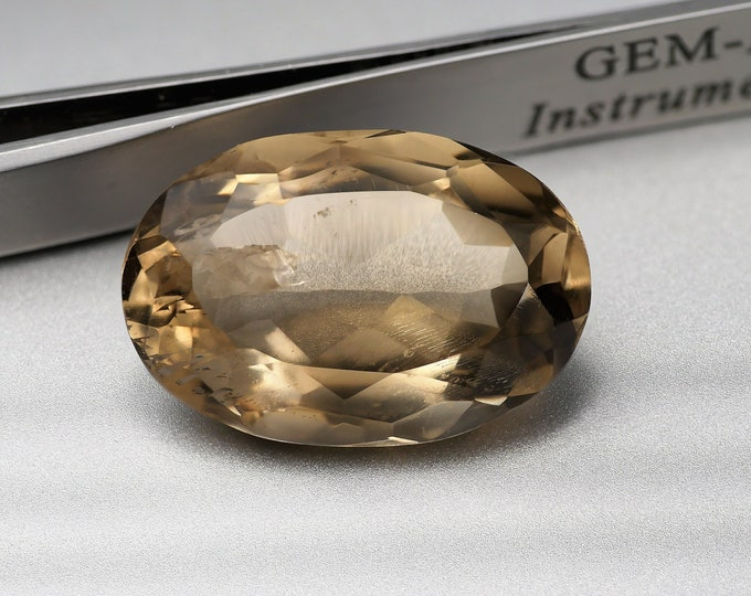 BEIGE / ENFUME QUARTZ - stone faceted oval cut - 29.55 cts - 25 X 17 X 11 mm - fitting jewelry