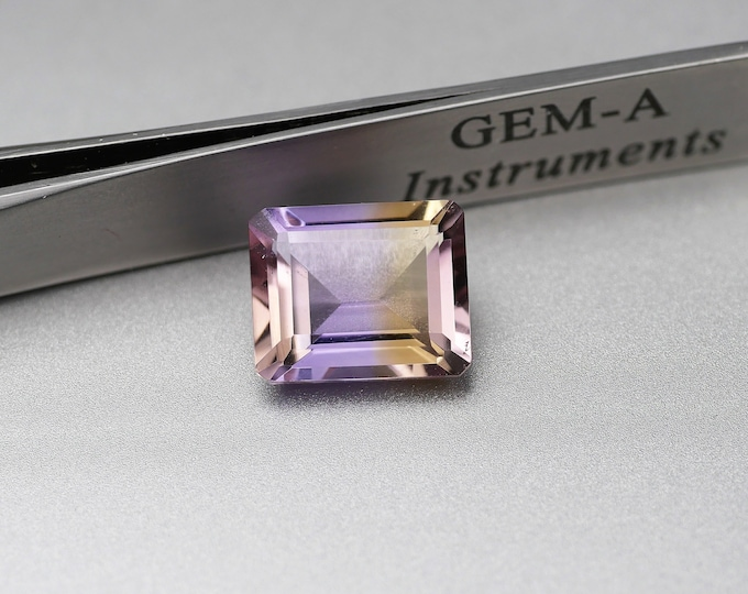 Purple/yellow - AMETRINE - faceted - size Emerald - 5.2 CT - 12X10X7mm