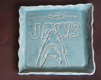 "Hand Carved ""Jaws"" themed clay plate"
