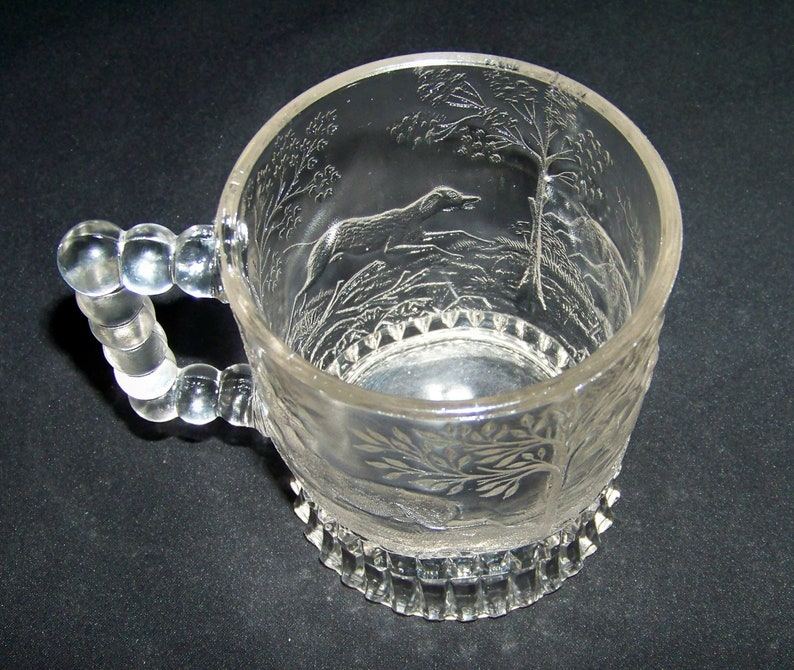 EAPG Bryce Brothers Glass Dog Chasing Deer Handled Mug
