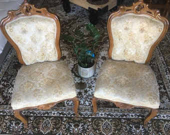 A pair of carved wooden chairs EGST