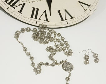 Metal bead, rosary style necklace