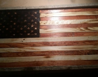 Stained and burned American flag out of reclaimed wood