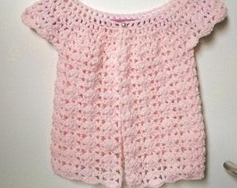 Young girls pretty shell, crochet cardigan