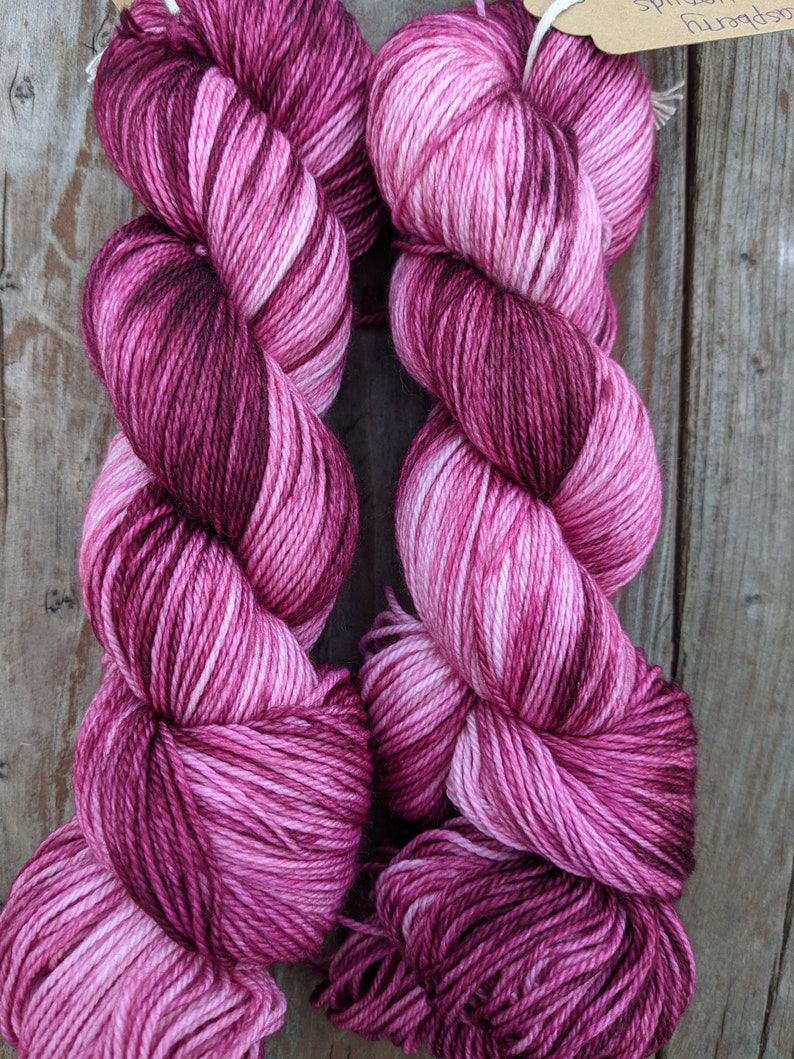100 gram Raspberry swirl Fingering weight and worsted 400yds and 220 yds sw merinonylon and highland wool