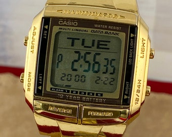 Vintage Casio DB-360 2515 5 Function Watch 30-Page Databank 8 letters and 12 numerals per page Auto-sort function 13 languages