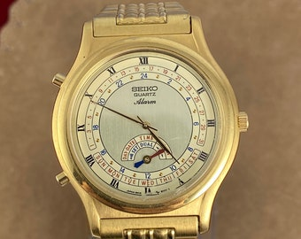 Extremely Rare and Vintage SEIKO Alarm Quartz Japan Movement Gold Tone Watch Marked 8M15-8009