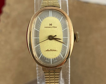 Vintage 1970's Hamilton Electronic 10K GF Watch. Has a Silver and Gold Color Dial White Hands Markers Expansion Bracelet