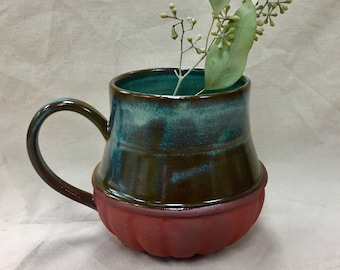 Large, handmade variegated blue mug