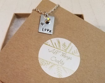 Hand stamped 'love' necklace with heart and jem