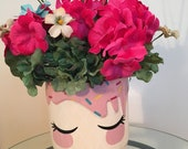 Girl 39 s face in colorful ceramic vase, bright pink floral arrangement, unique decorative container, blue bow in hair
