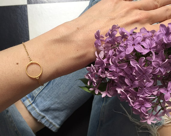 Bracelet with circle, ring, round, gold finished brass. Delicate, filigree and minimalist.