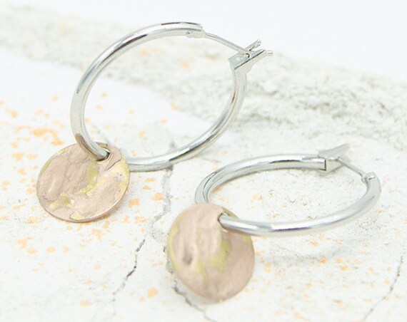 Creole silver colored, rhodium. With round rosévergoldetem plate pendant. Matte and shiny surface, beautiful look. Hoops!