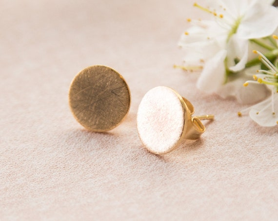 Gold stud earrings. Circle brushed, round, gold finished brass. Super discreet, delicate and minimalist.