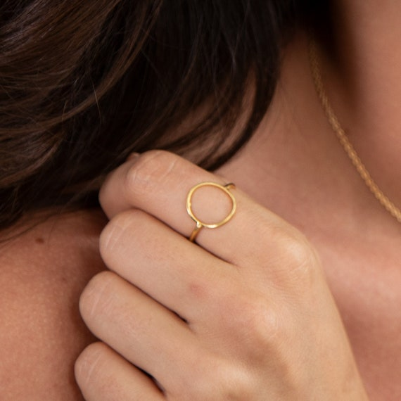 Circle Ring Gold refined minimalist and adjustable. Gold finished brass. Basic and must have