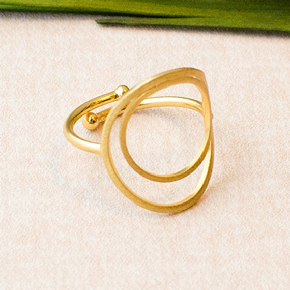 Circular ring double, adjustable, matted. Available in rose or gold finished brass