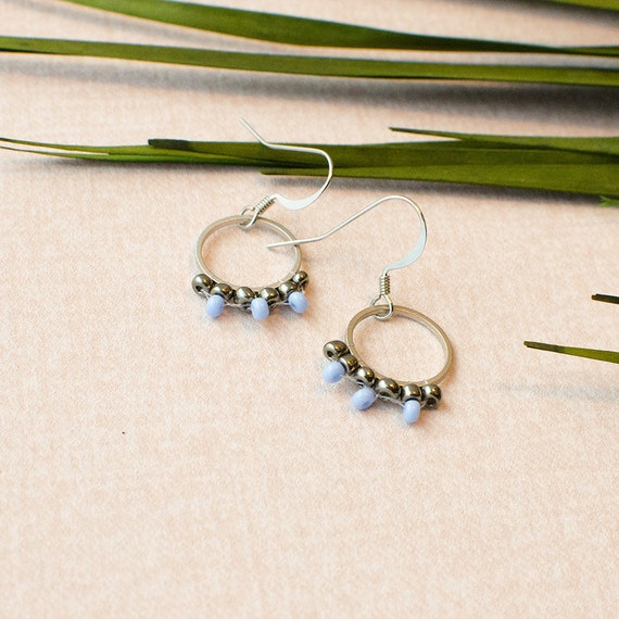 Boho Hippie Earrings Silver colored with small jewelry beads.
