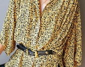 vintage 80 s Nicole Miller relaxed yellow blouse. Light weight yellow top with black pattern.