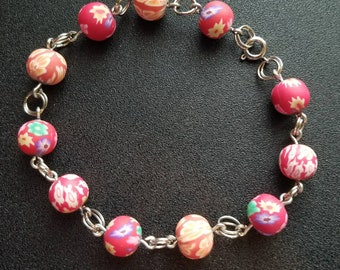 Hot pink floral polymer clay beaded bracelet