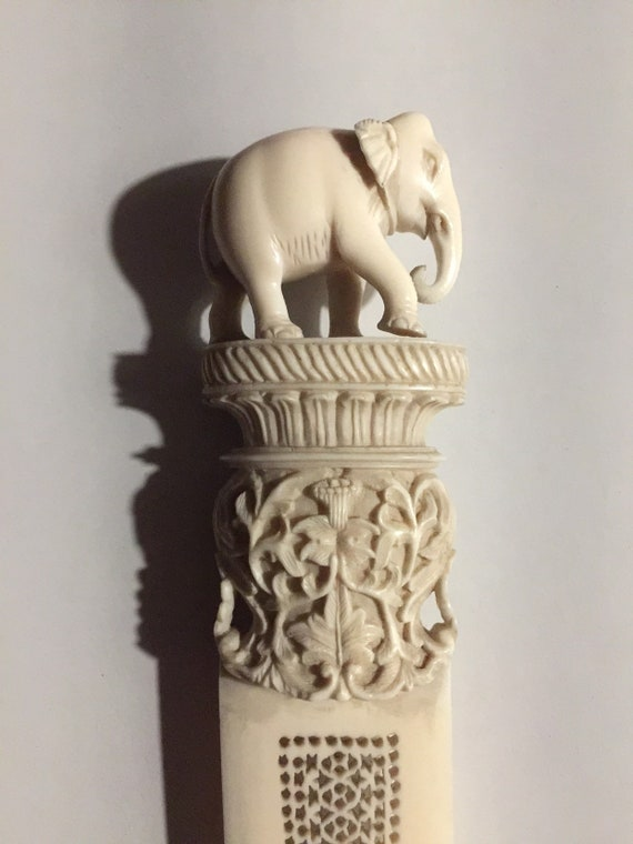 Antique 1900s Finely Carved Page Turner topped with beautifully carved Elephant