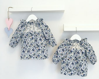 D I A N A baby blouse with ruffle and lace decoration.