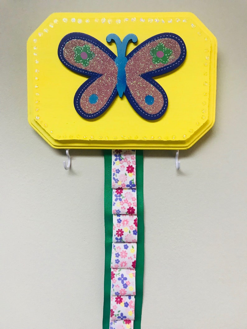 Wooden plaque measures 5 X 7 in Wall mount overall length 26 12 inches. Beautiful butterfly hard headband and clip holder