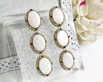 Silver handmade earrings are made of white nacre,beads and crystals. Long beaded elegant  earrings